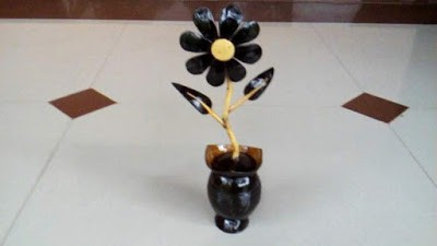 Gambar kerajinan dari batok kelapa bunga